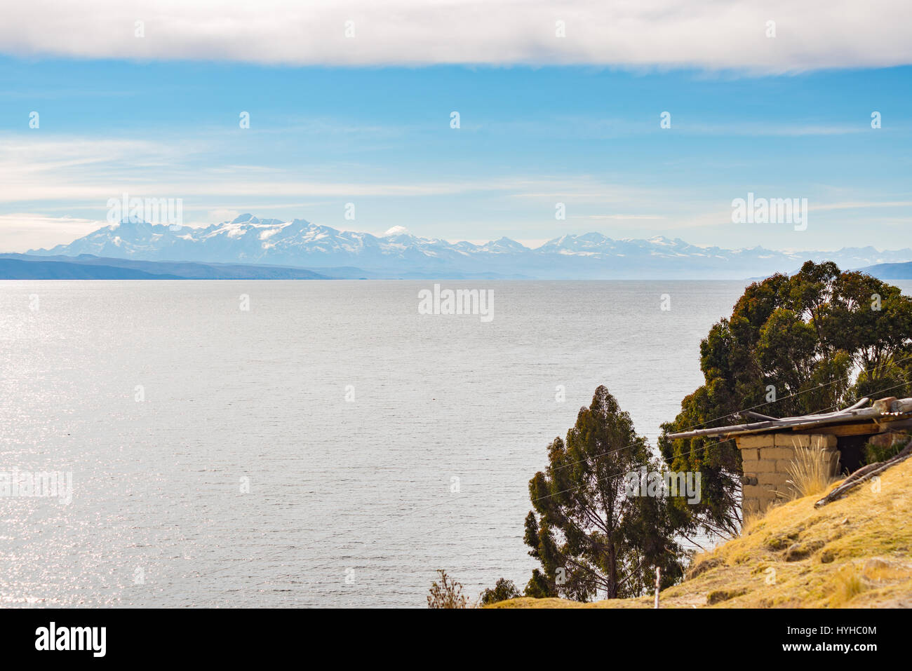 The majestic Cordillera Real mountain range at the horizon of the Titicaca Lake. Telephoto view from the Island - Stock Image