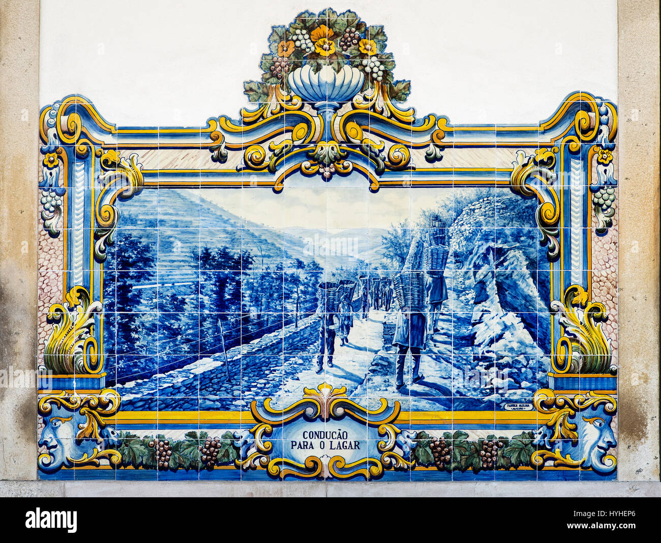 Scene of the wine harvest in the Douro region on cermaic tiles, azulejos, Pinhao, Douro Valley, Portugal - Stock Image