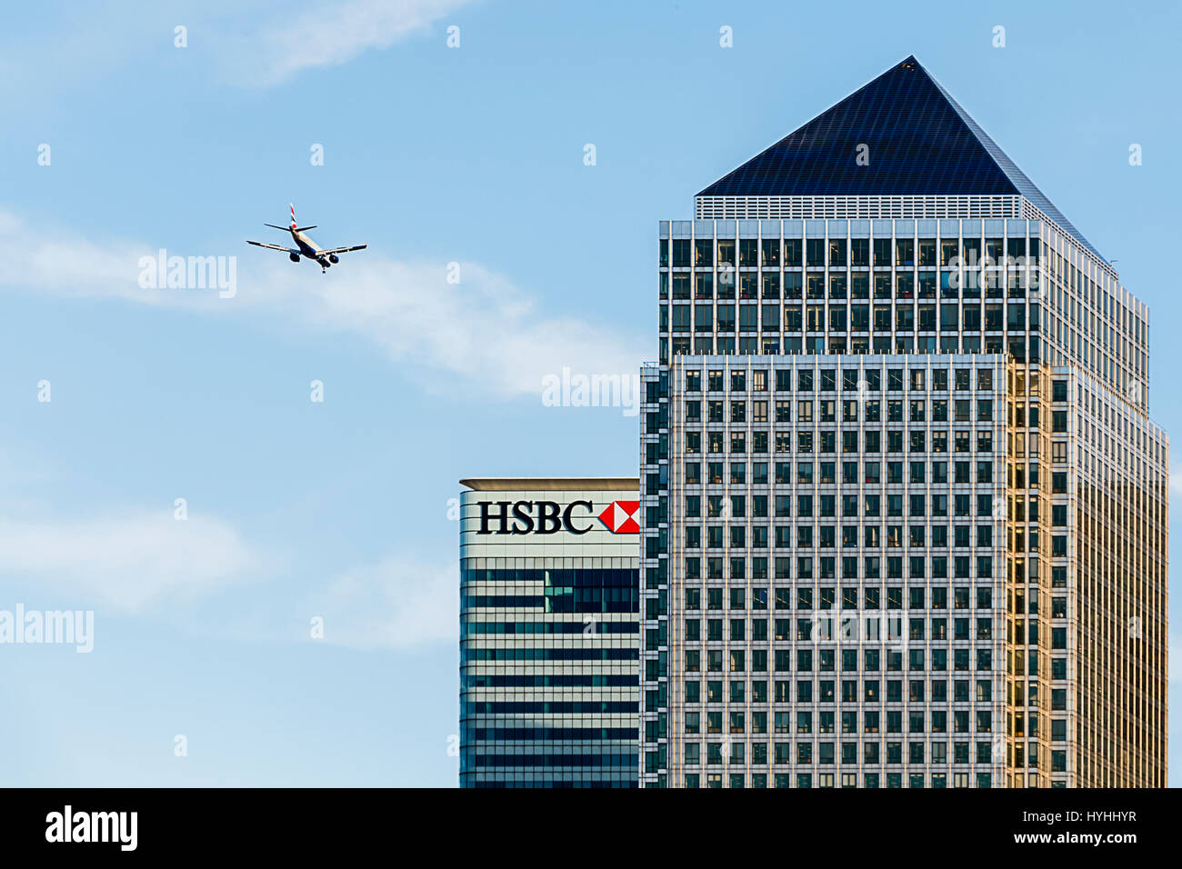 Aircraft Flying Over One Canada Square, Canary Wharf, London - Stock Image