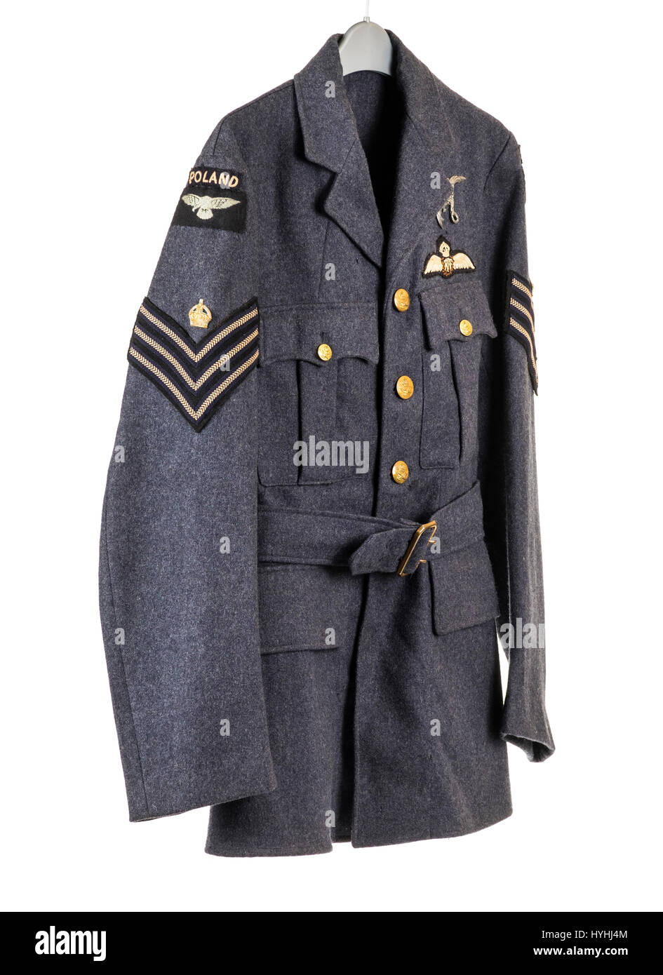 WW2 RAF tunic worn by a Sergeant with the Polish Air Force, with cloth RAF wings, Poland shoulder badges and stripes - Stock Image