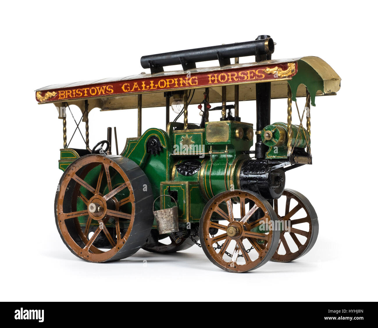 Vintage tinplate model steam traction engine with green bodywork and canopy inscribed 'Bristows Galloping Horses' - Stock Image