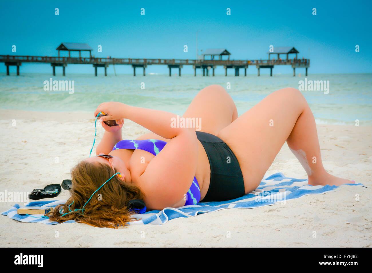 People laying out in bikini
