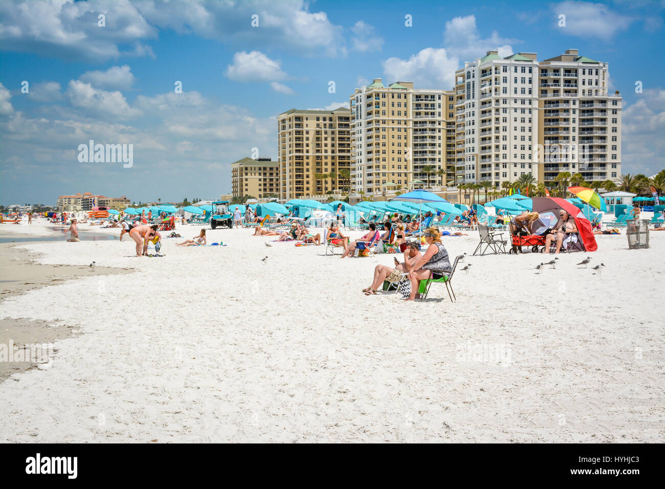 Popular white sand beach full of umbreallas, baech chairs & people enjoy the sunny day on Clearwater Beach, - Stock Image