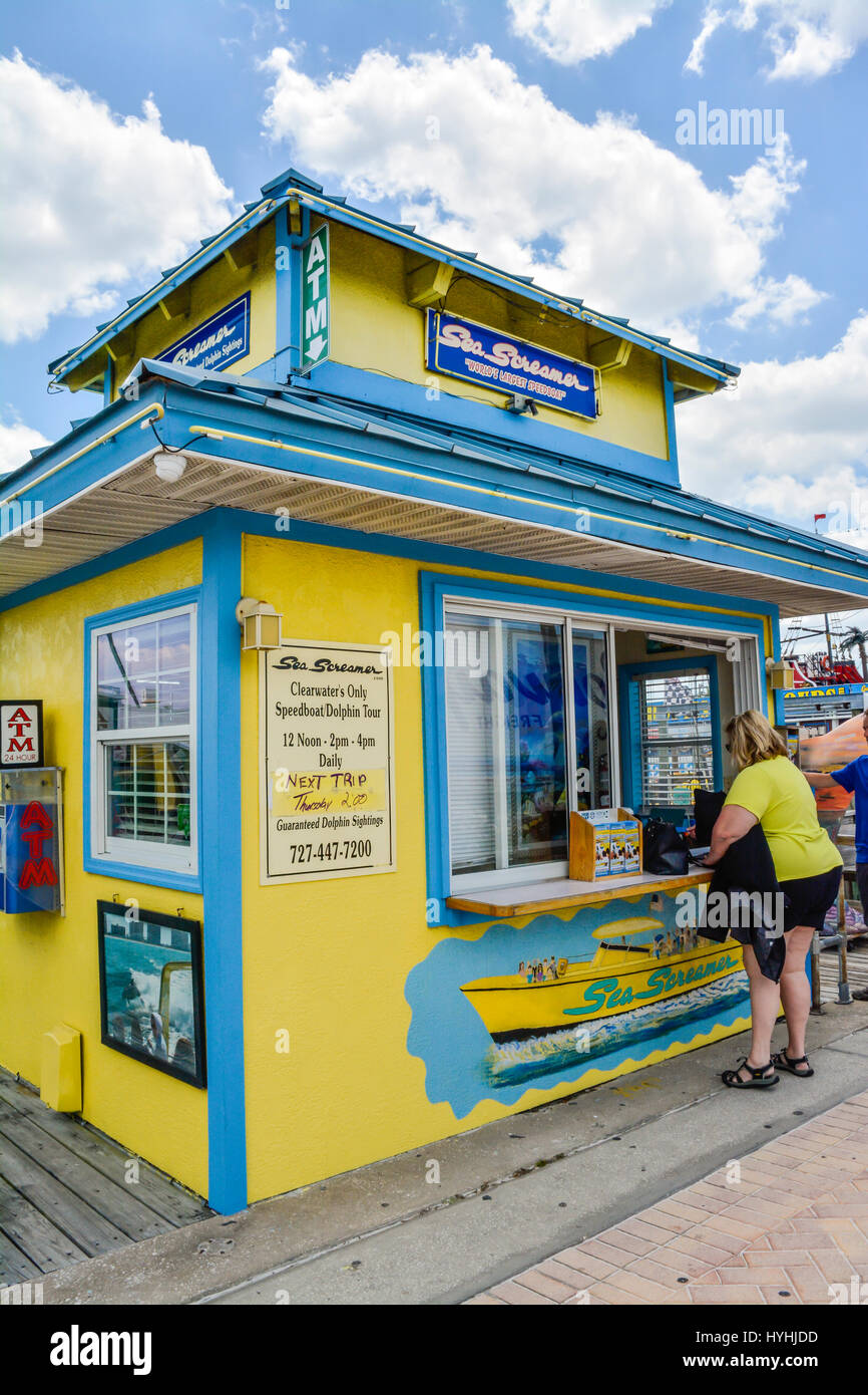 A customer at the window of The Sea Screamer ticket office on the Clearwater Beach Marina, FL sells Dolphin  tours - Stock Image