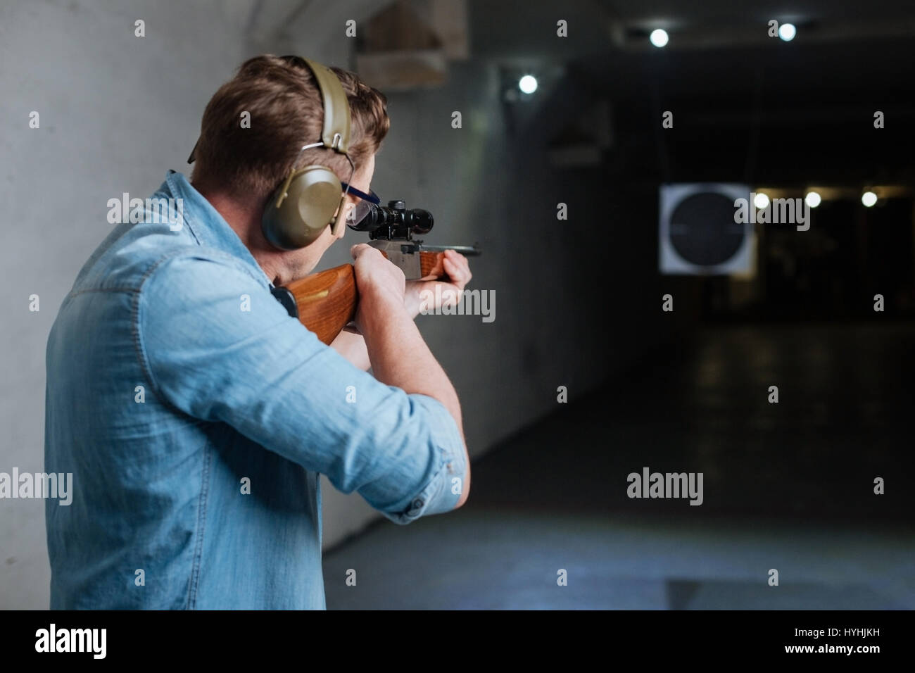 Handsome serious man looking at the target - Stock Image