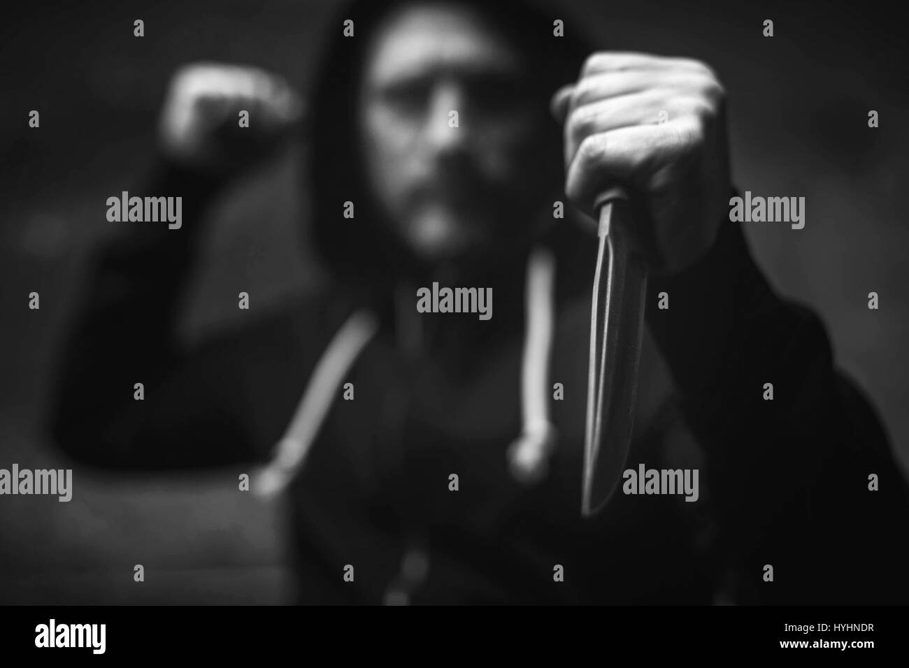 Violent senseless maniac stabbing his victim - Stock Image