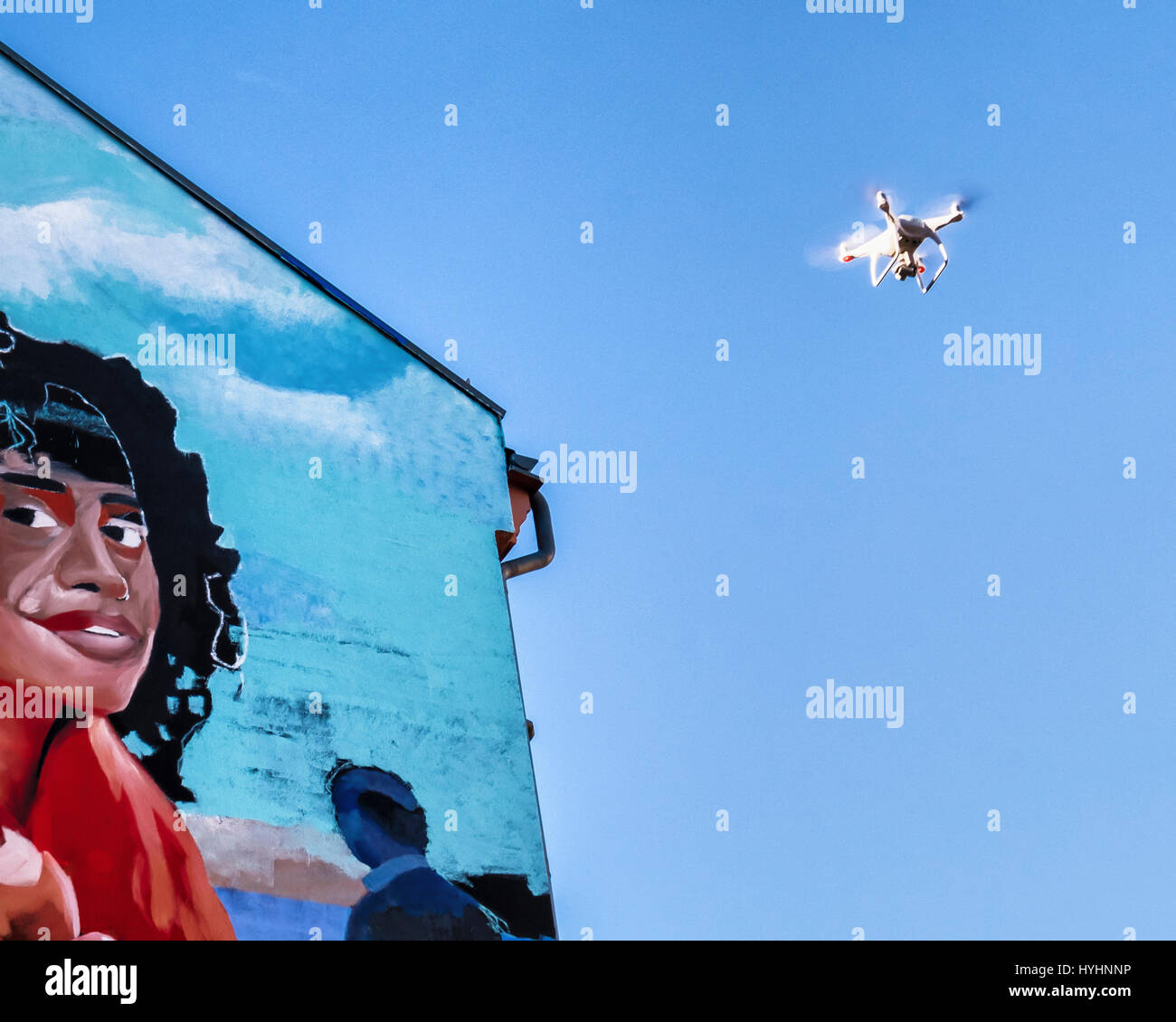 Berlin, Mitte. Mural  Mercedes-Benz advertisement. Painting by commercial artists - photograph and video recording - Stock Image
