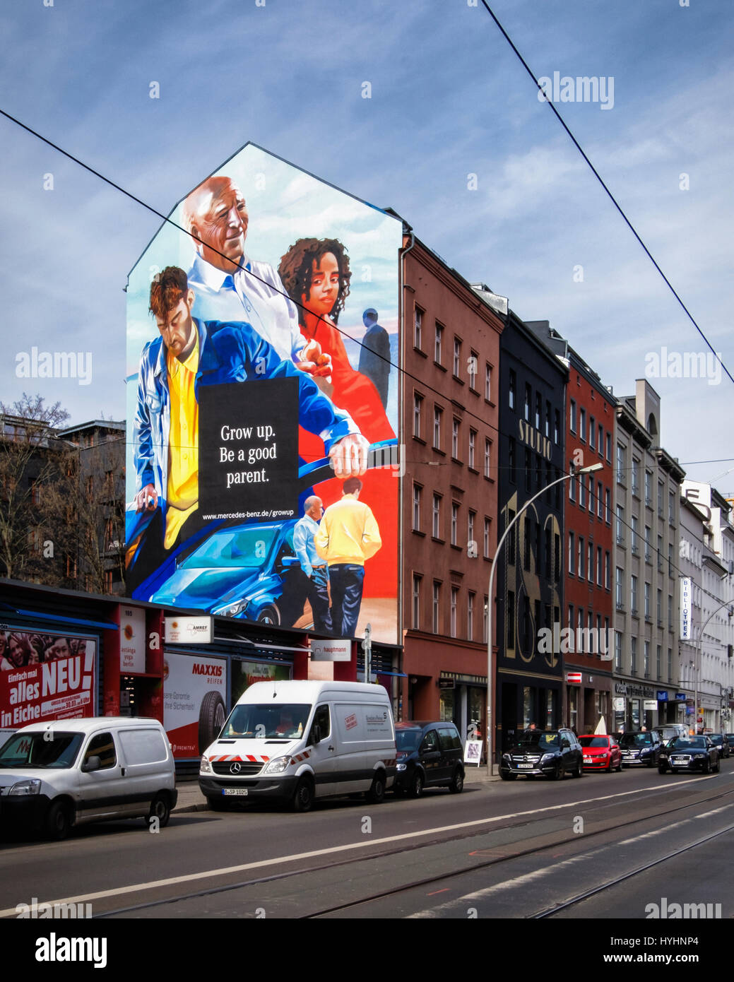Giant mural Mercedes Benz advertisement in Mitte Berlin. Advertising Slogan,Grow up,be a good parent - Stock Image