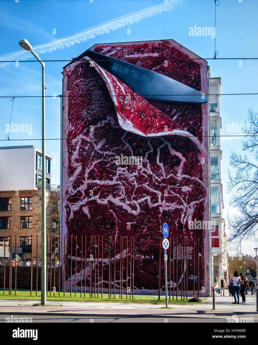 Berlin,Mitte.The steak mural by Marcus Haas.Giant artwork of knife slicing meat represents division of East & - Stock Image