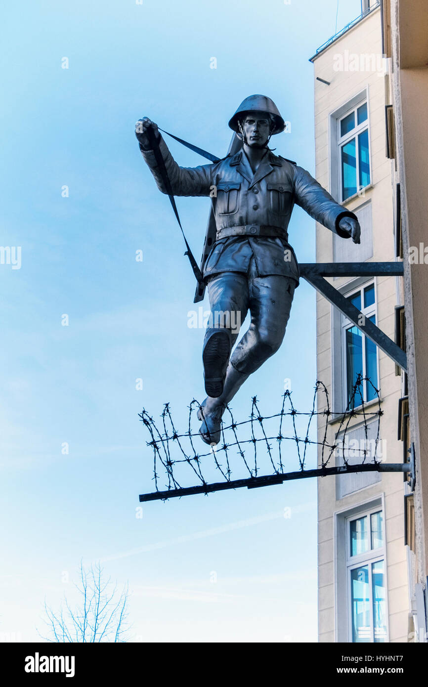Berlin,Mitte.Wall jumper,Jumping soldier sculpture.East German Border guard, Conrad Schumann, jumps over barbed wire to escape from East Berlin Stock Photo