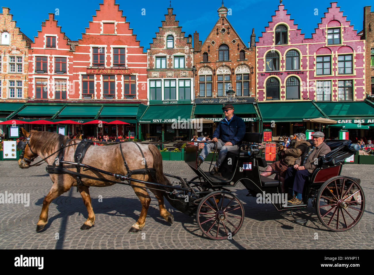 Horse carriage in Markt or Market Square, Bruges, West Flanders, Belgium - Stock Image