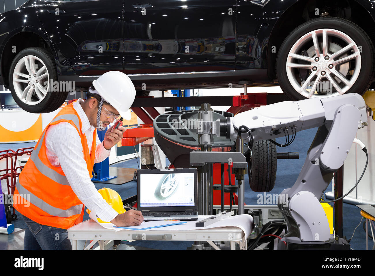 Automotive engineer with assistance robotic inspect modern car, Industry 4.0 concept Stock Photo