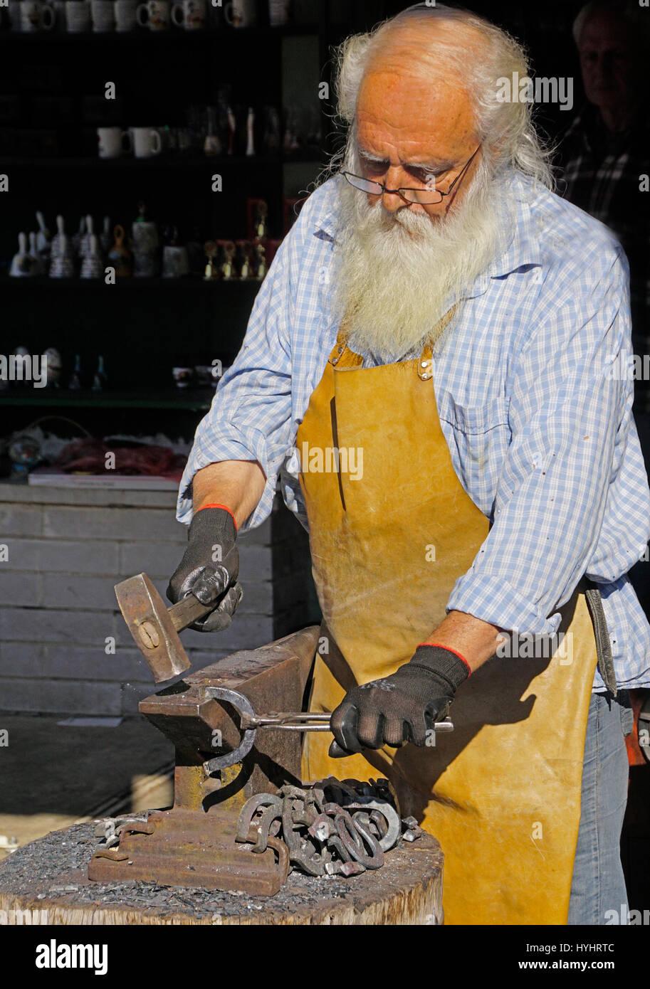 Blacksmith making horse shoes in Cetinje, Montenegro. - Stock Image