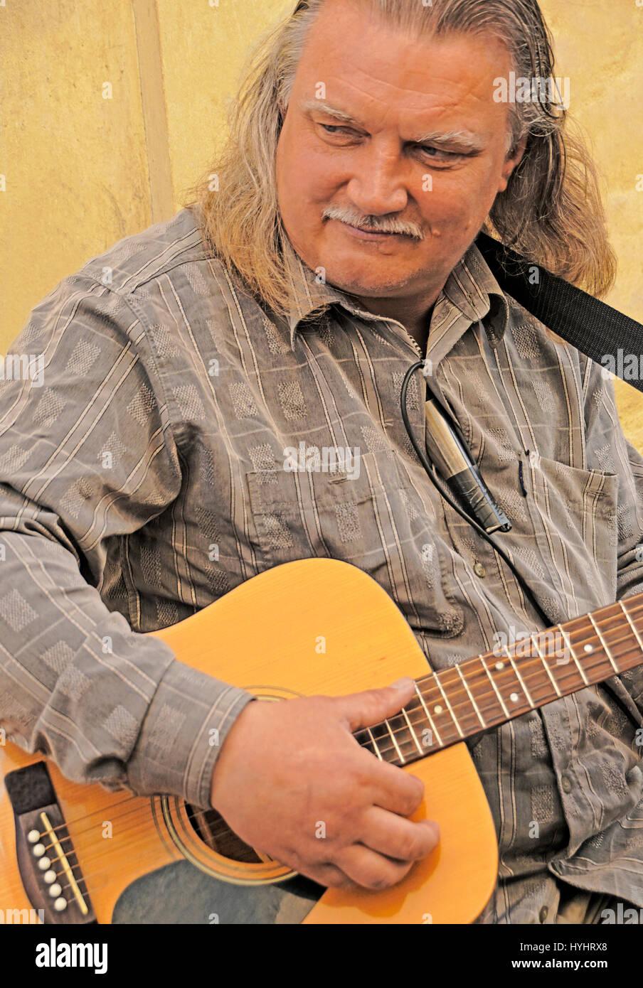 Guitar street musician in Tallinn, Estonia. - Stock Image