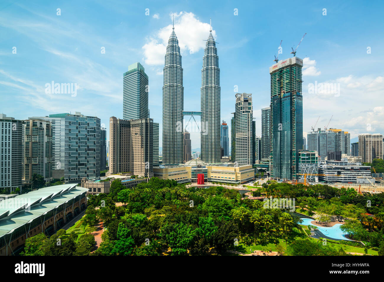 Petronas Twin Towers and Central Kuala Lumpur Skyline across KLCC Park, Malaysia - Stock Image