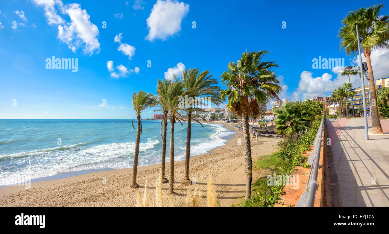 Beach and seafront promenade in Benalmadena. Malaga province, Andalusia, Spain - Stock Image