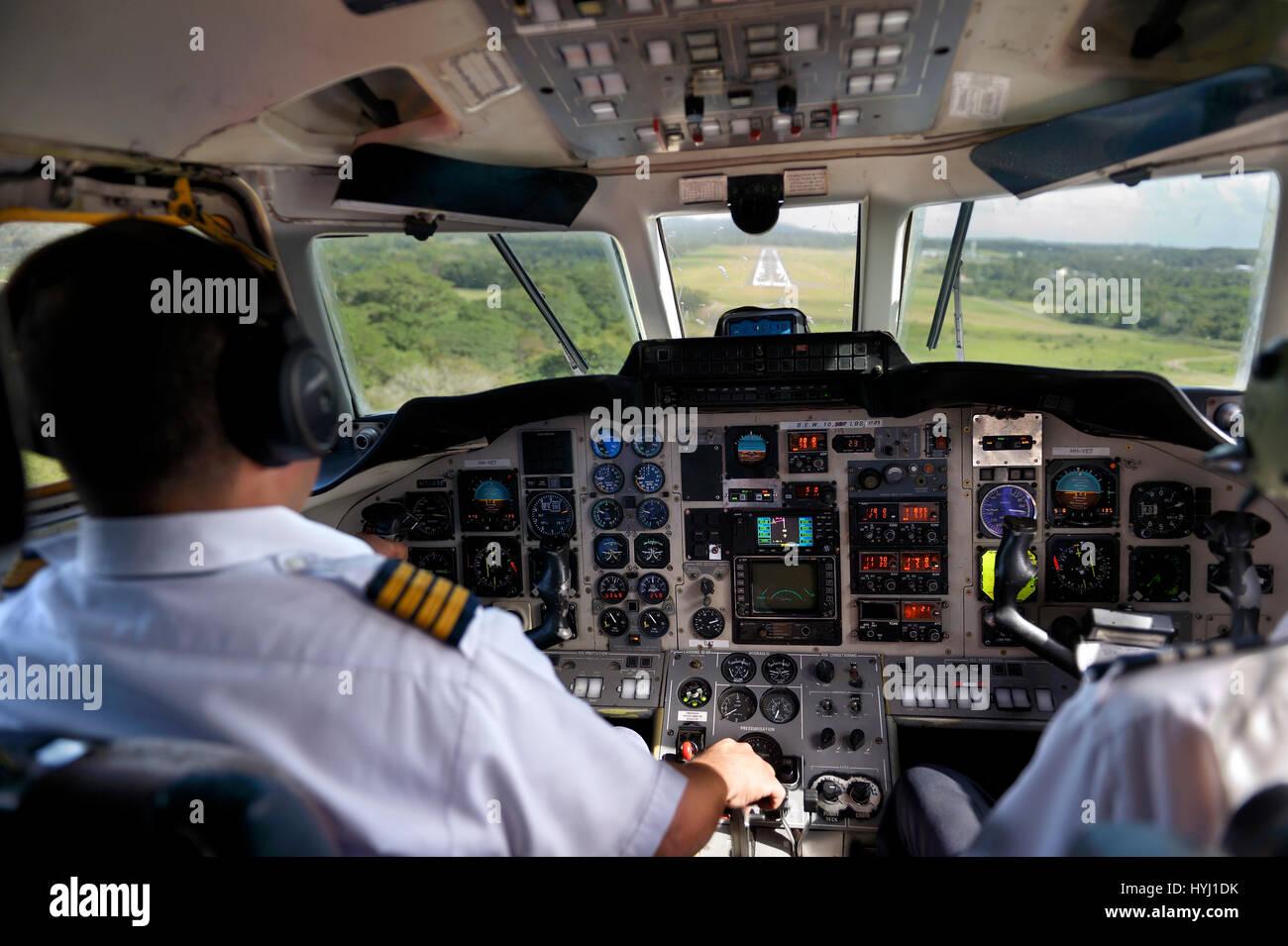 Landing, pilot and copilot control the twin-engine propeller aircraft British Aerospace Jetstream 3200, La Isabela - Stock Image