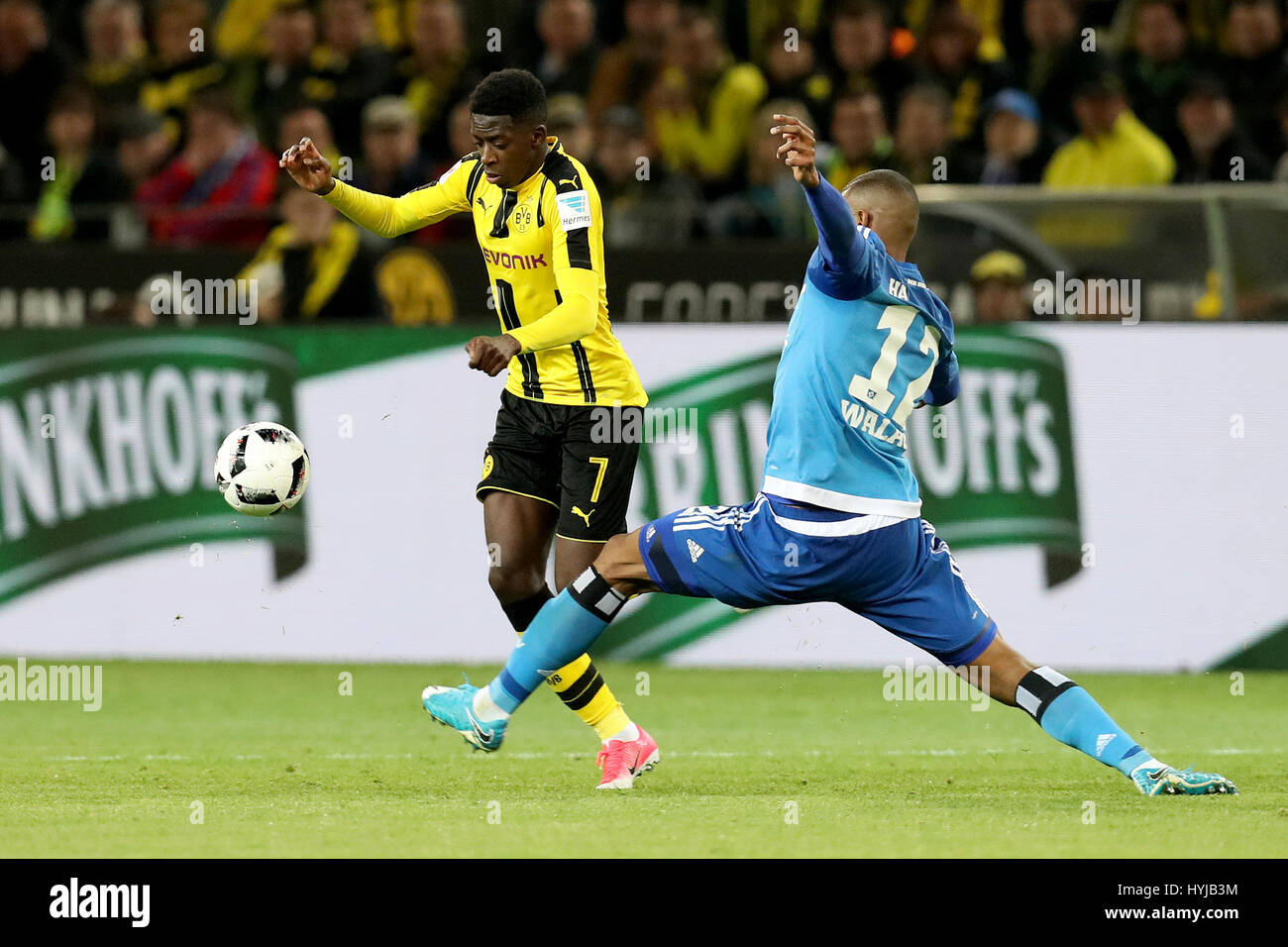 Dortmund. 4th Apr, 2017. Ousmane Dembele (L) of Dortmund vies with Walace of Hamburger SV during the Bundesliga - Stock Image