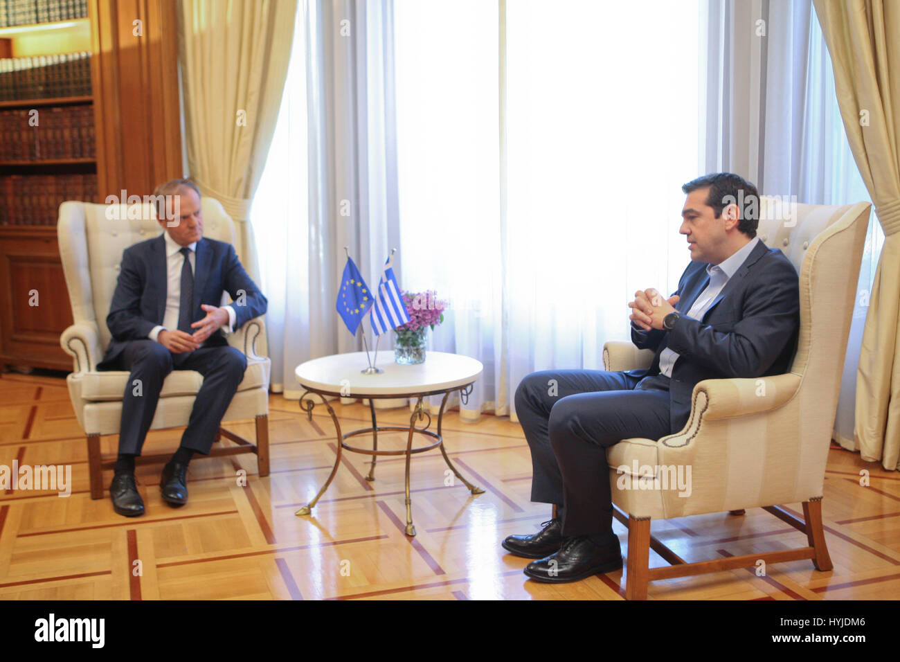Athens, Greece. 5th Apr, 2017. Greek Prime Minister Alexis Tsipras, right, listens to European Council President - Stock Image