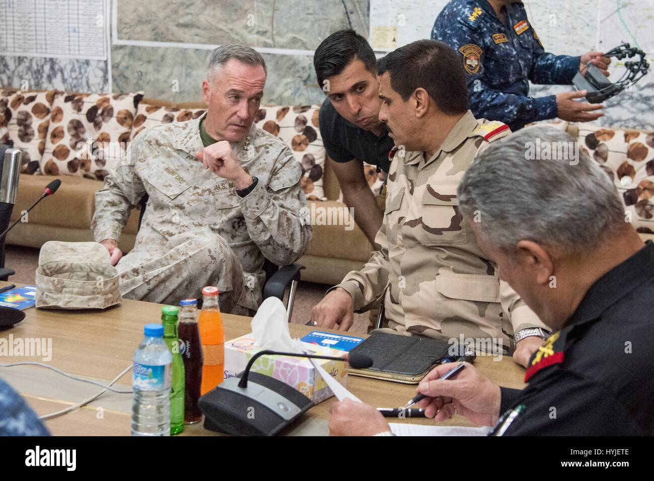 Qayyarah West, Iraq. 04th Apr, 2017. U.S. Joint Chiefs Chairman Gen. Joseph Dunford, left, during a briefing by - Stock Image
