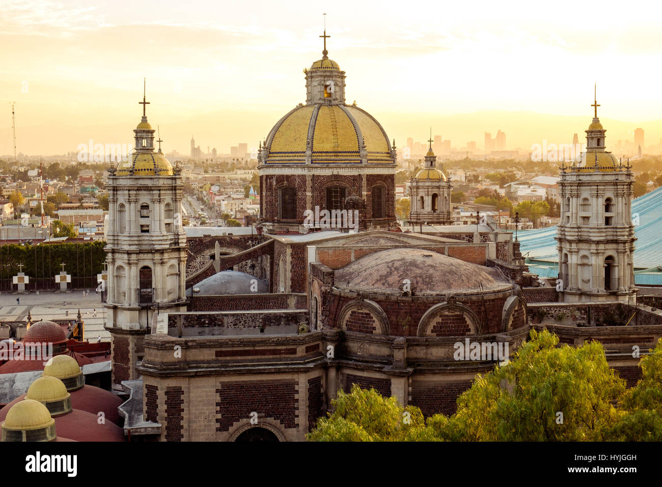 Scenic view of Basilica of Guadalupe with Mexico city skyline at sunset, Mexico - Stock Image