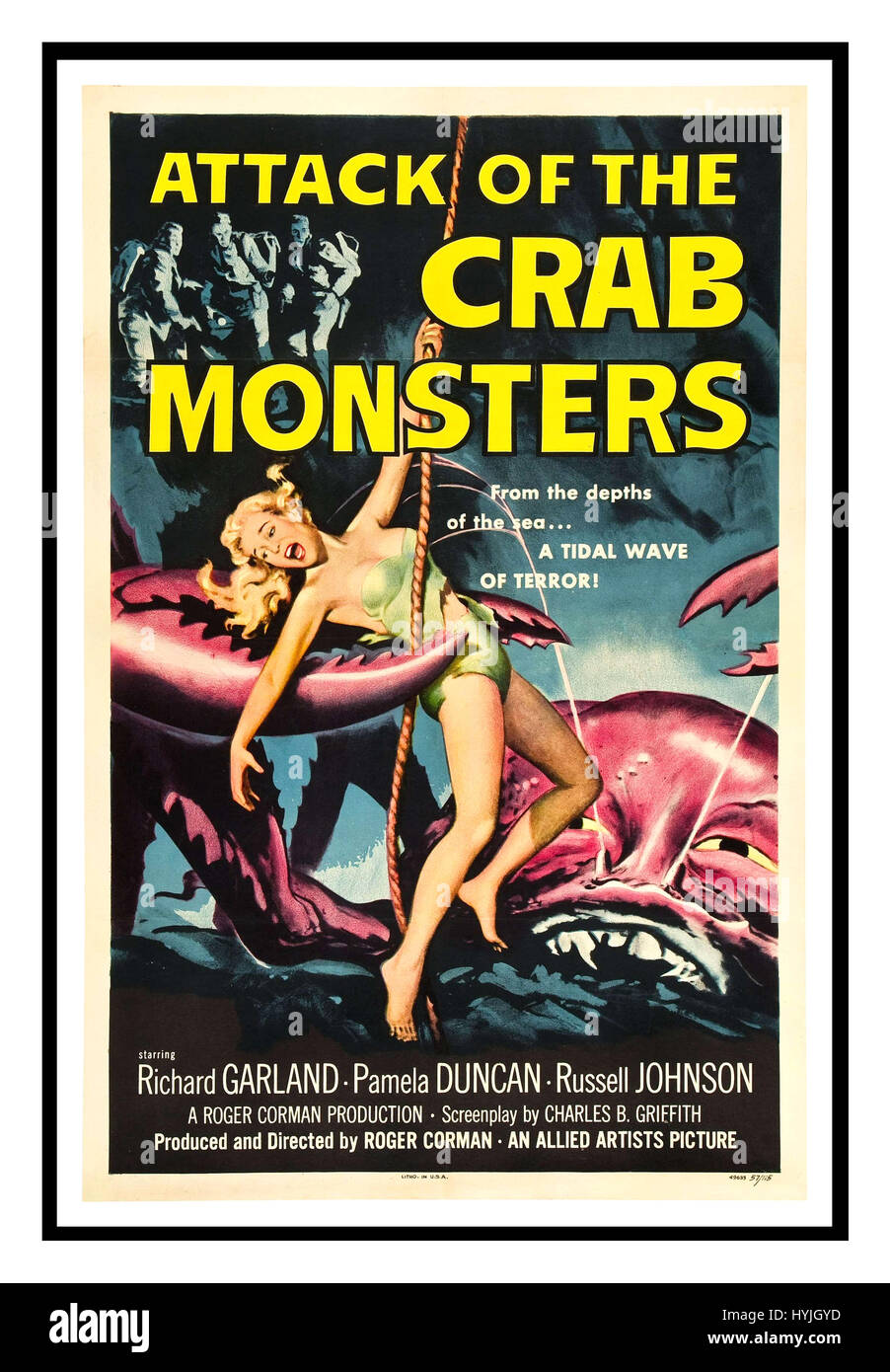 Vintage film poster advertises the horror sci-fi movie of 1957 Attack of the Crab Monsters produced and directed - Stock Image