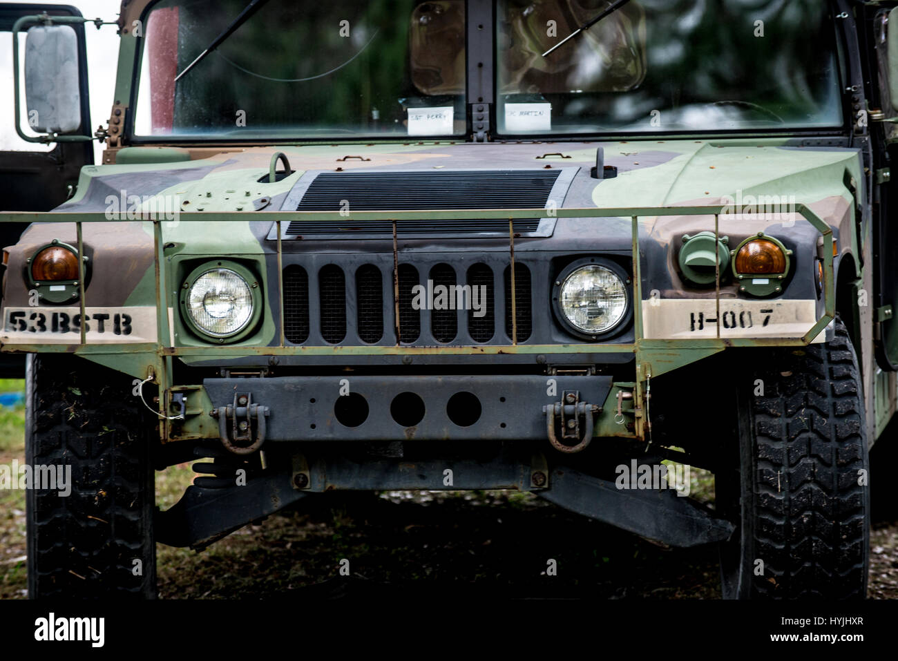 front of military hummer - Stock Image