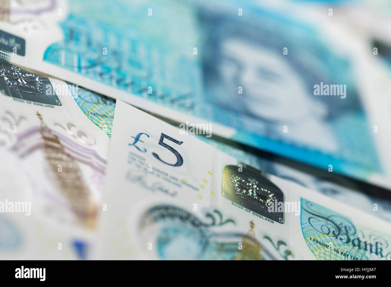 British Currency close up - pile of New Polymer Five Pound Notes, Sterling, Cash - Stock Image