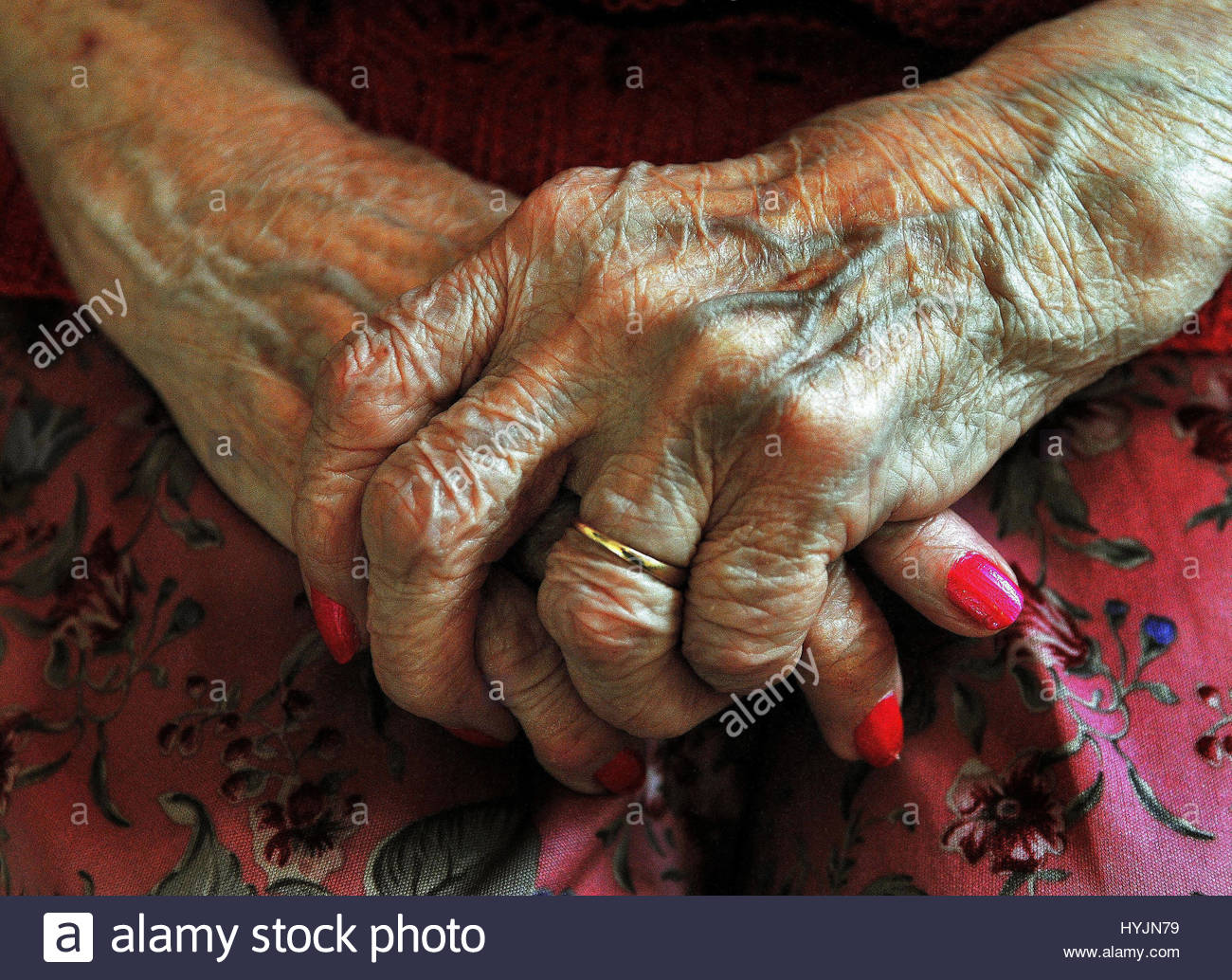 File photo dated 05/12/08 of the hands of an elderly woman. One in 10 councils have cut their spending on social - Stock Image
