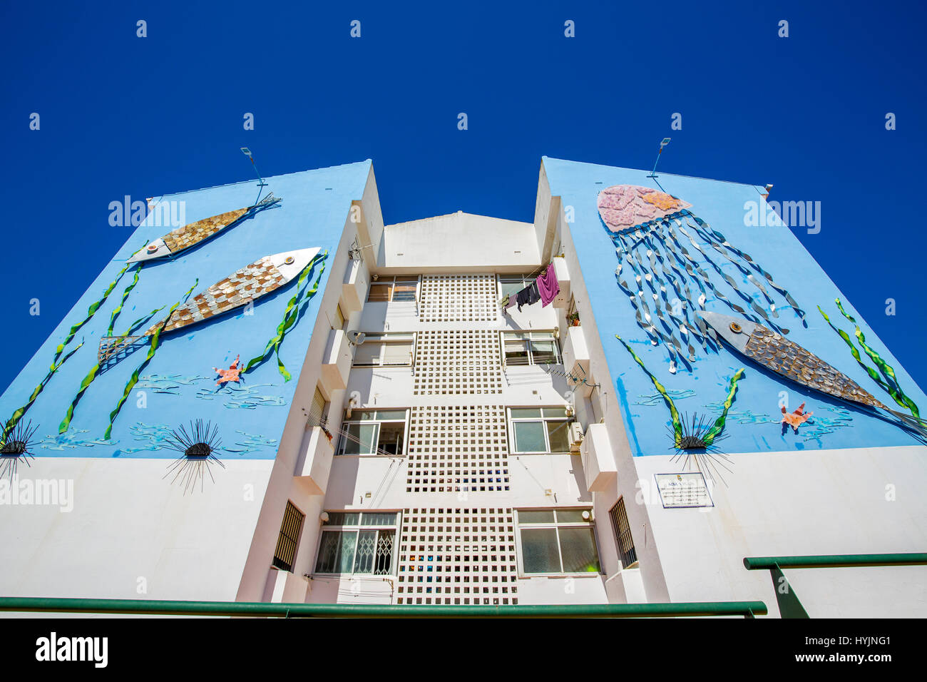 Artwork. Urban art that decorates the facade of an apartment building, Estepona. Malaga province Costa del Sol. - Stock Image