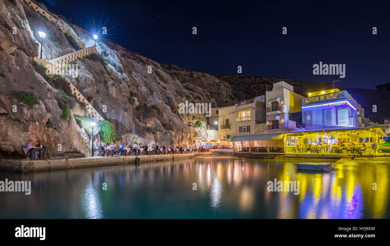Xlendi, Gozo - Beautiful cozy summer night at Xlendi Bay, the nicest mediterranean town on the island of Gozo which - Stock Image