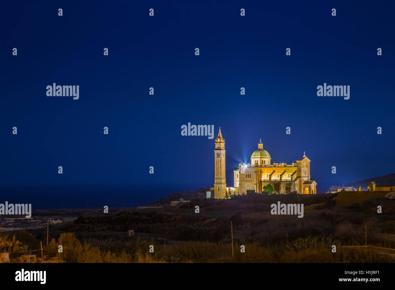 Gozo, Malta - The Basilica of the National Shrine of the Blessed Virgin of Ta' Pinu at night with clear starry - Stock Image
