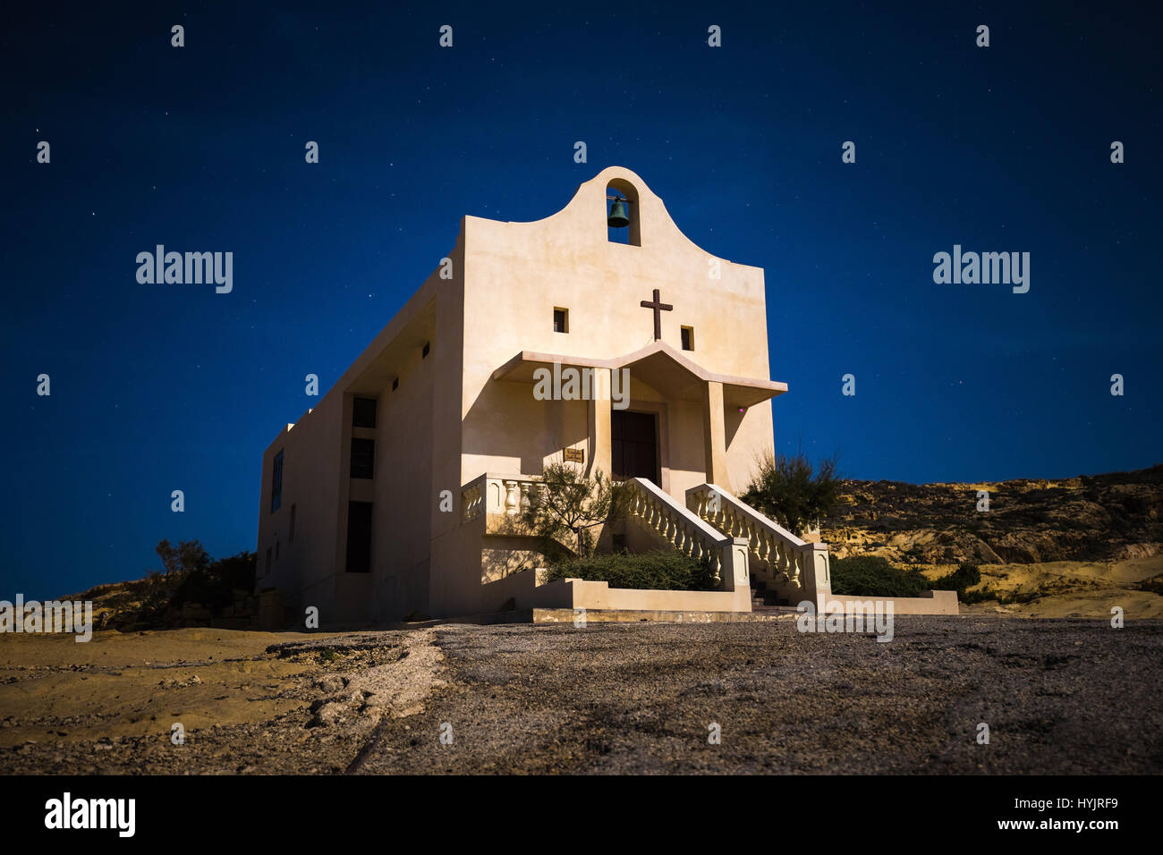 Gozo, Malta - The Saint Anne or Sant' Anna Chapel at Dwejra bay by night on the island of Gozo at full moon - Stock Image