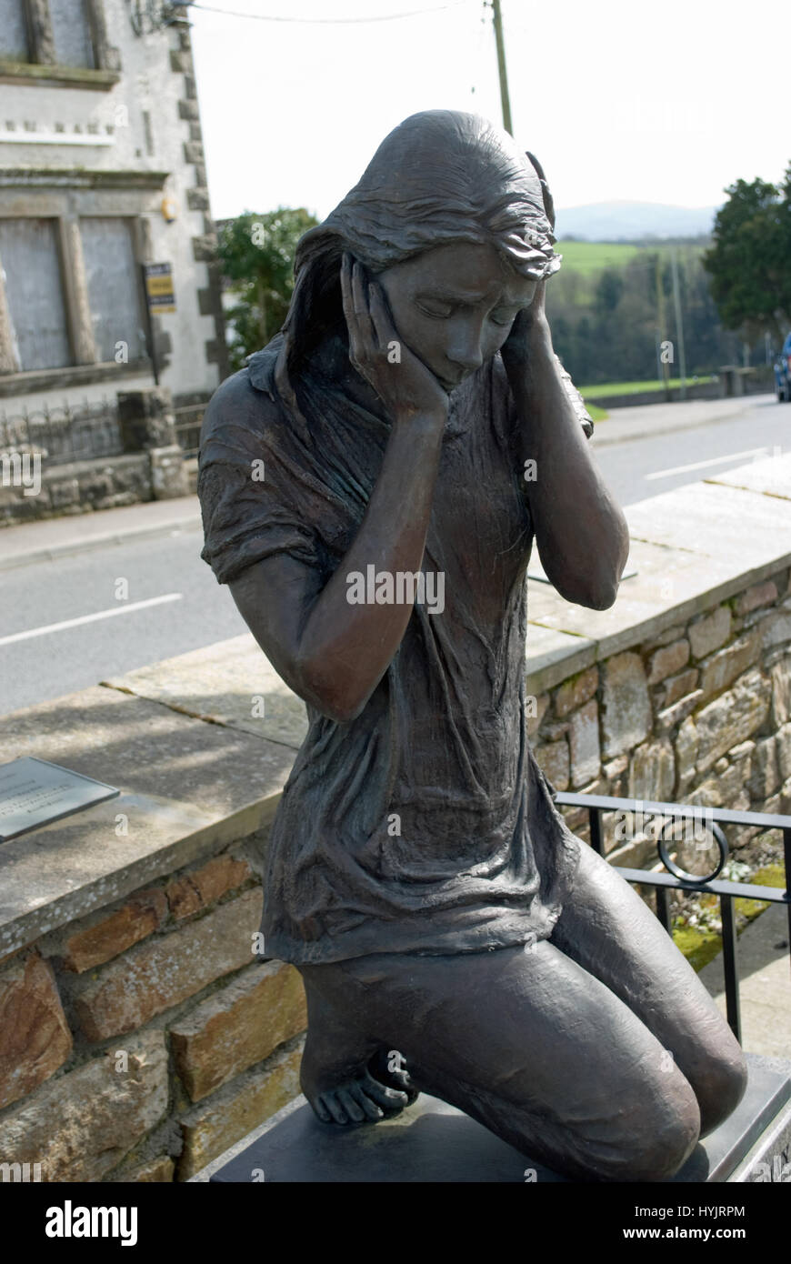 "Bronze memorial statue of a girl commerating the victims of the 1972 ""Bloody Monday"" bomb blast which killed nine Stock Photo"