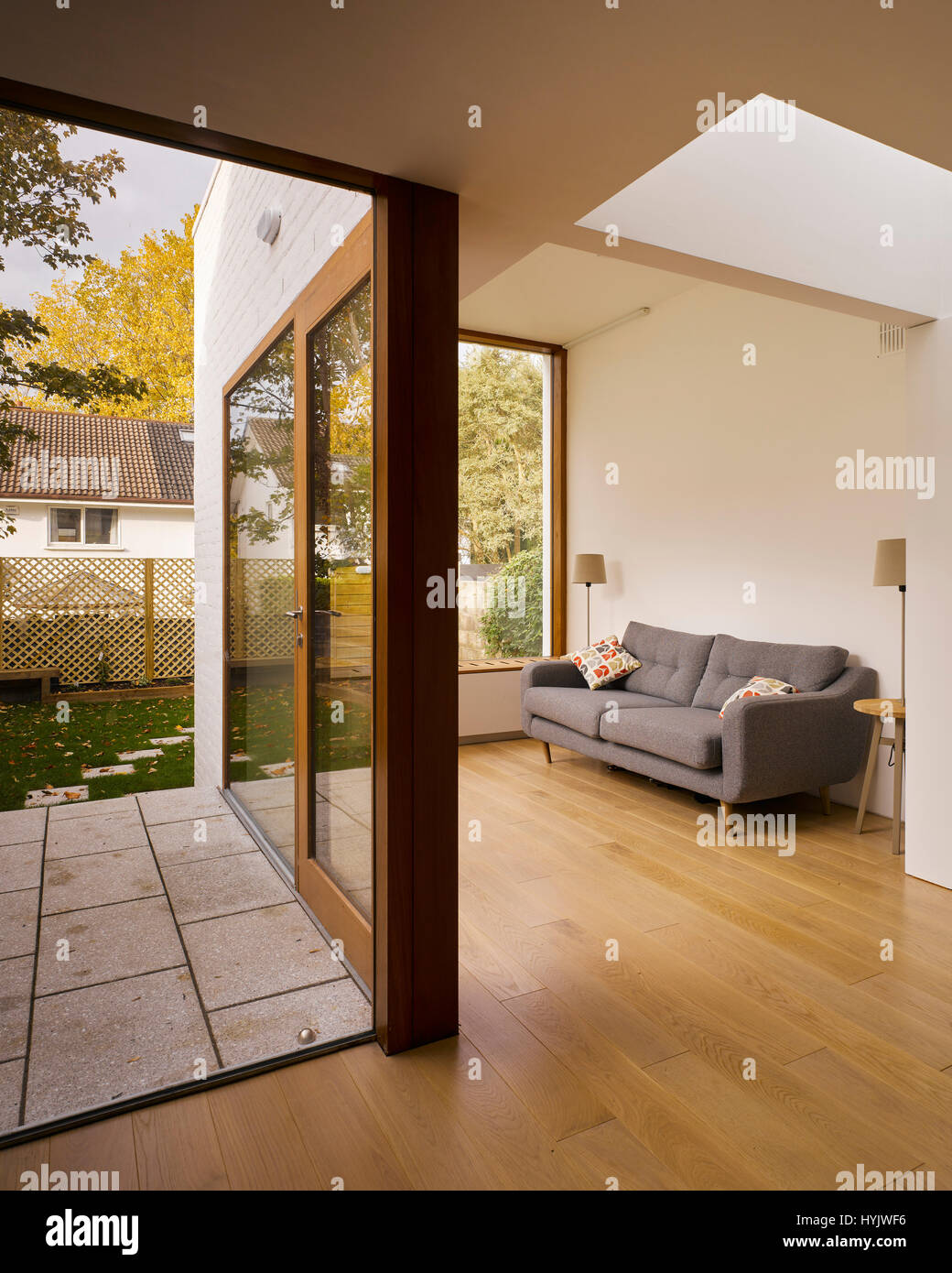 Interior view of living area showing glass doors to exterior. Extension to House, Stillorgan, Dublin, Ireland. Architect: - Stock Image