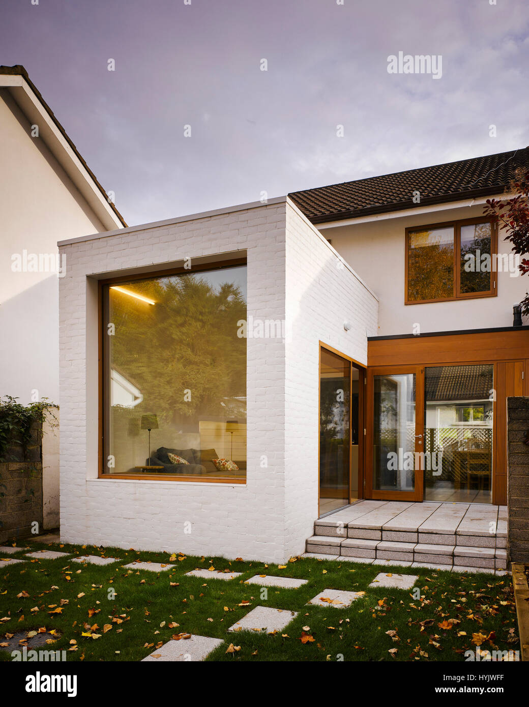 Exterior view of extension showing window and glass doors. Extension to House, Stillorgan, Dublin, Ireland. Architect: - Stock Image