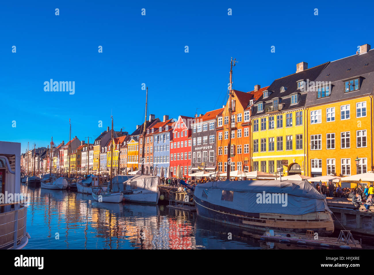 COPENHAGEN, DENMARK - MARCH 11, 2017: Copenhagen Nyhavn canal and promenade with its colorful facades, 17th century - Stock Image