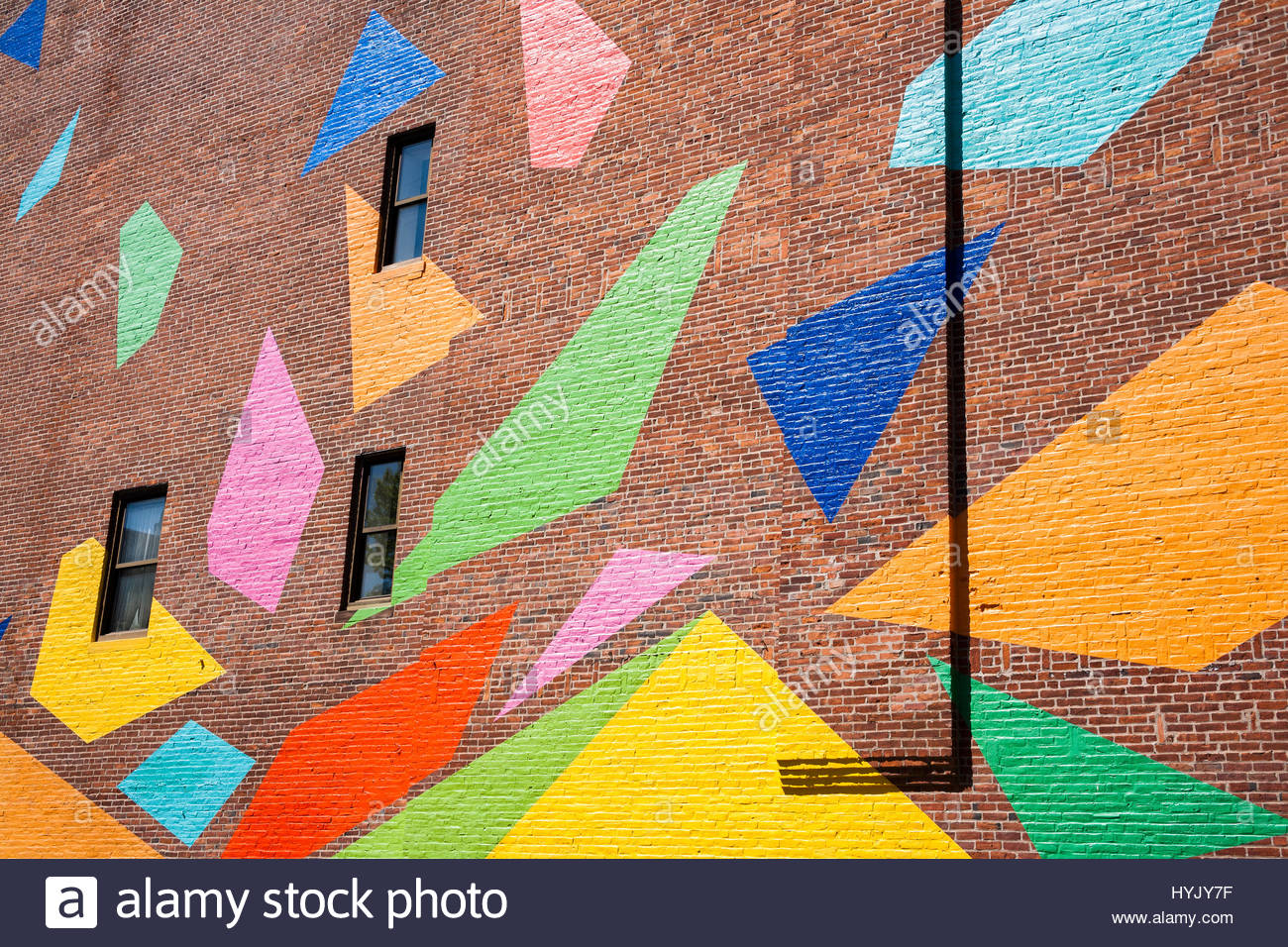 Color shapes painted onto exterior office building wall. - Stock Image