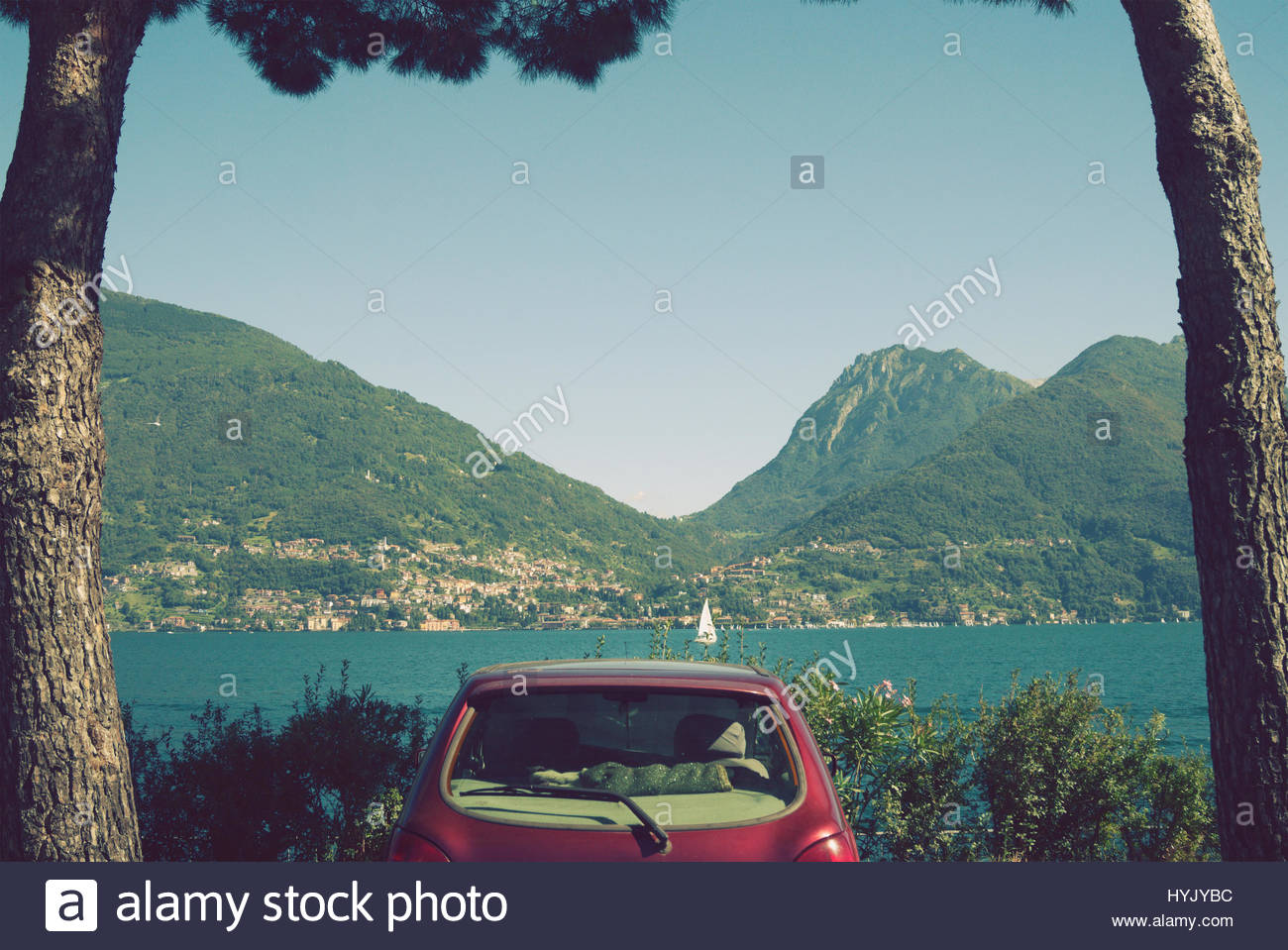 parked car on the shore of Lake Como, Italy - Stock Image