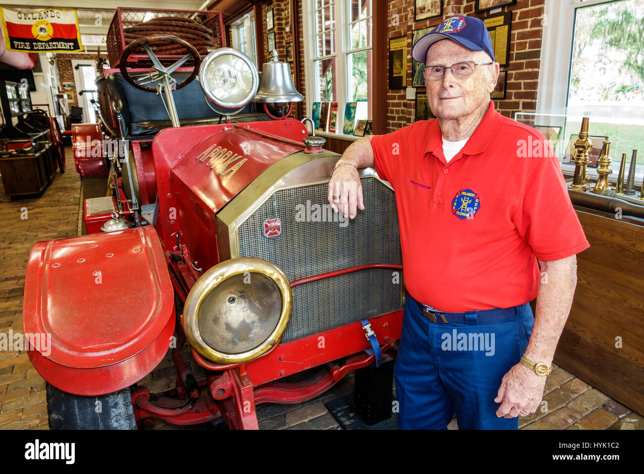 Orlando Florida Loch Haven Park cultural park Orlando Fire Museum firehouse interior man senior retired firefighter - Stock Image