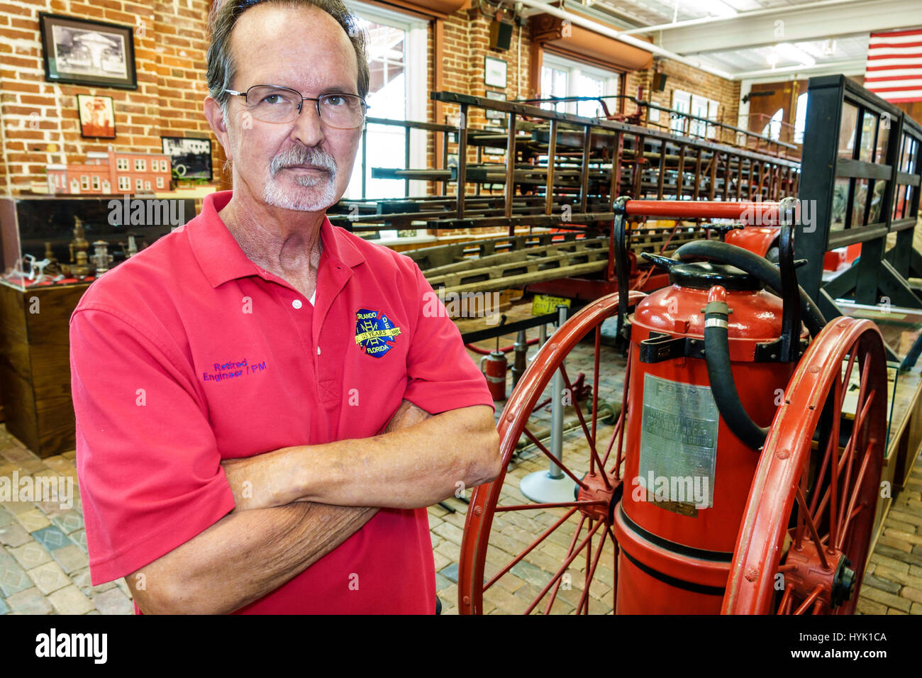 Orlando Florida Loch Haven Park cultural park Orlando Fire Museum firehouse interior man retired firefighter volunteer - Stock Image