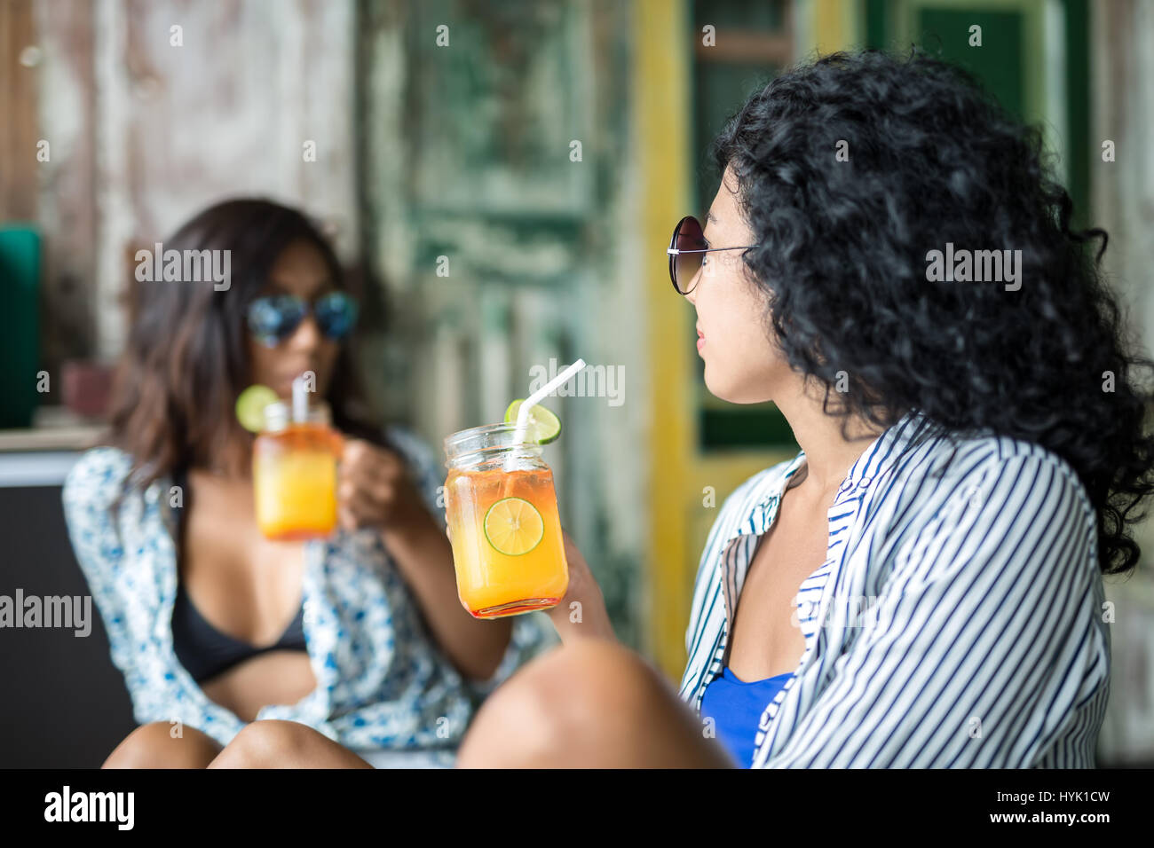 Girls with cocktails - Stock Image