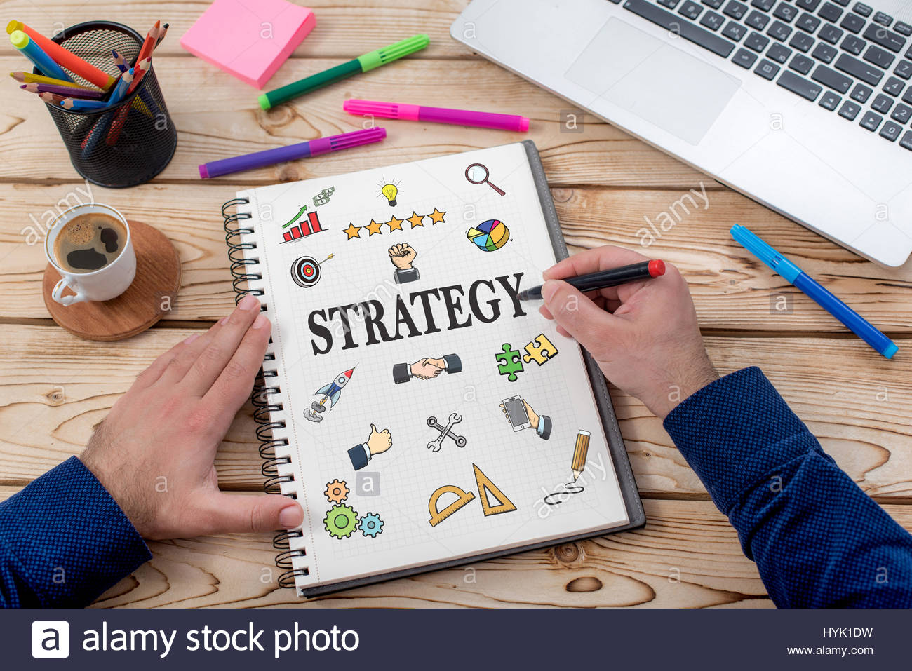 Strategy Concept With Various Hand Drawn Doodle Icons On Paper In Office - Stock Image