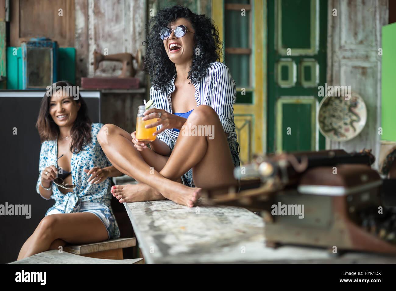 Asian girls in bar - Stock Image