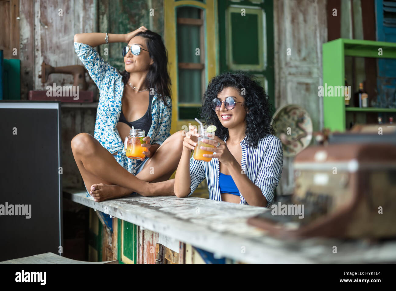 Asian girls in bar - Stock Image