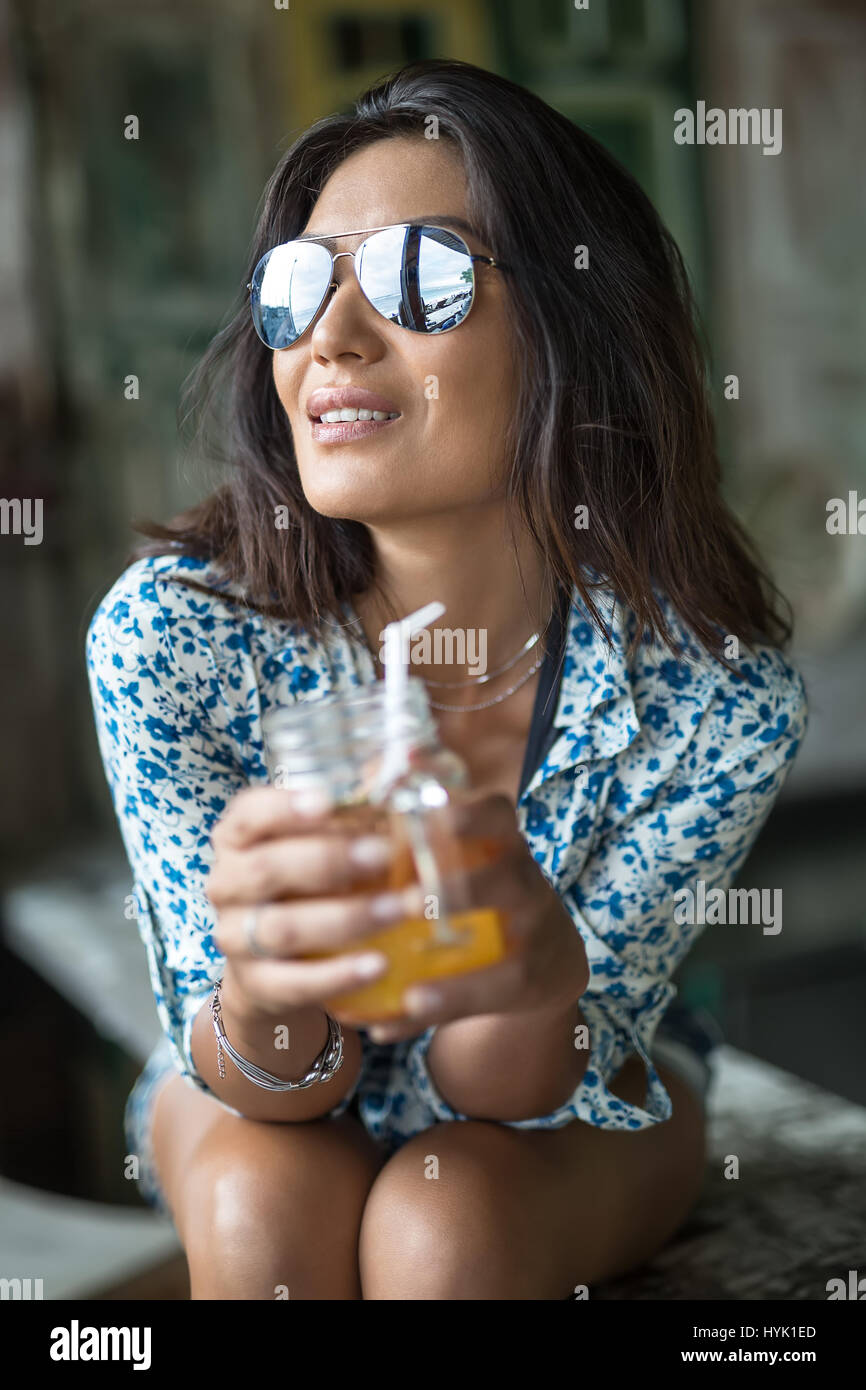 Girl with cocktail - Stock Image