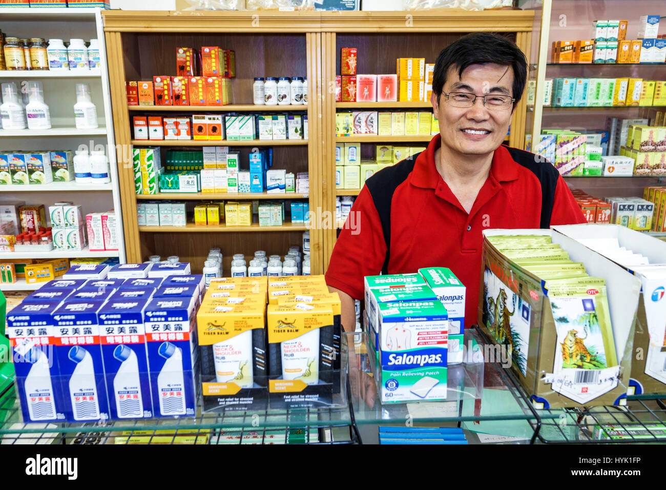 Orlando Chinatown Florida Health Food City health market Oriental alternative medicine pharmacy display Asian man - Stock Image