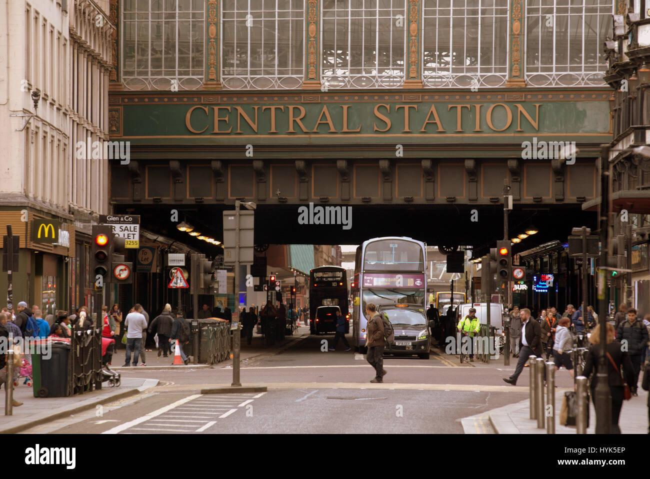 central station the highlanders umbrella Glasgow  street scene - Stock Image