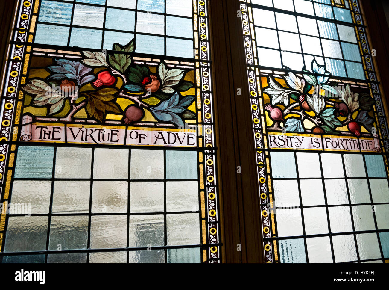 'The Virtue of Adversity is Fortitude' quote on stained glass window in Victoria BC provincial parliament - Stock Image