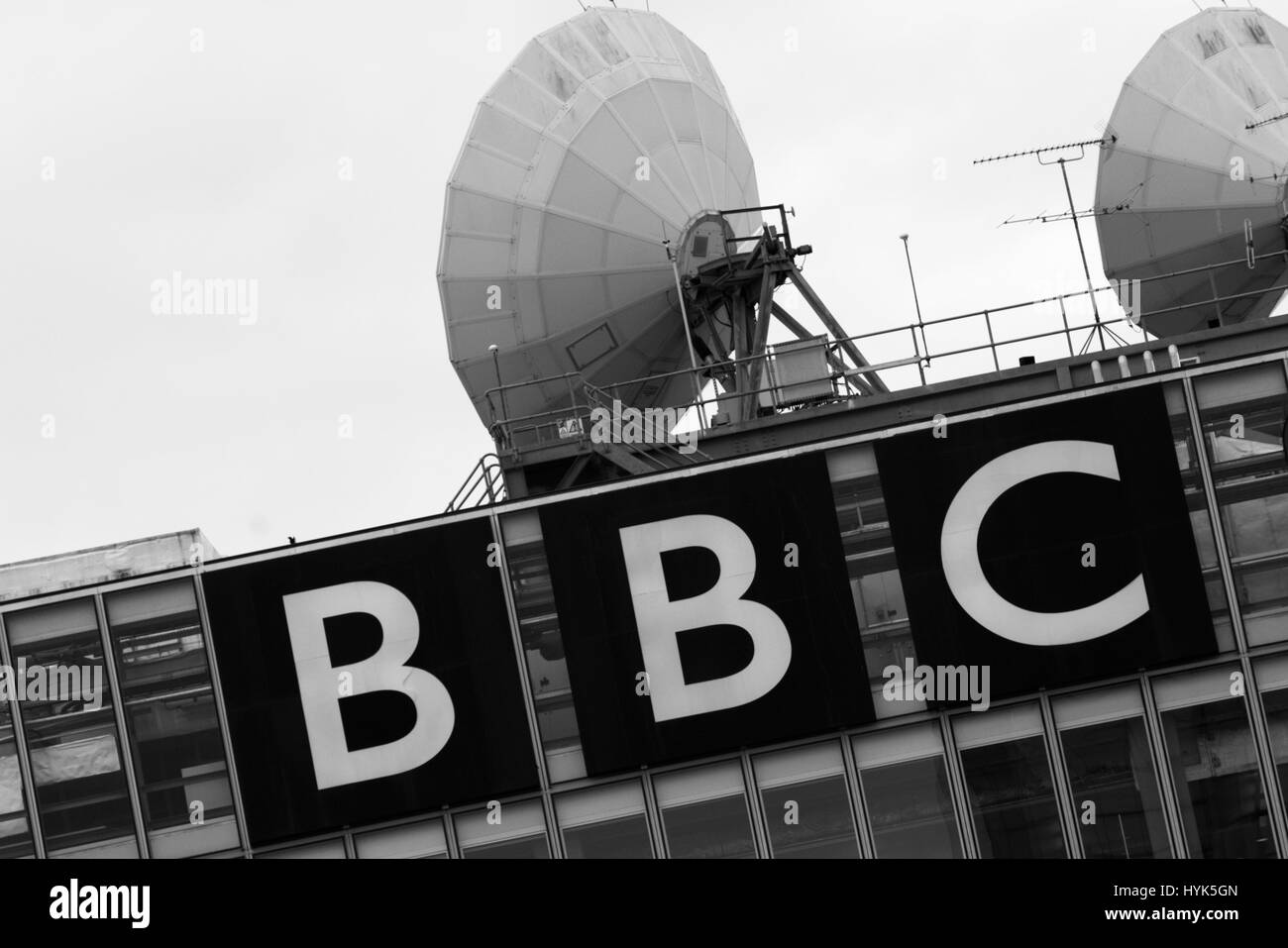 BBC logo with satellite dishes - Stock Image